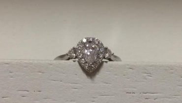 Pear Shaped Halo with diamonds either side