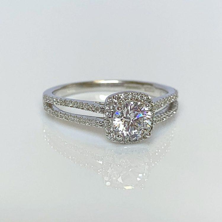 18ct White Gold & 0.76ct Diamond Halo Engagement Ring
