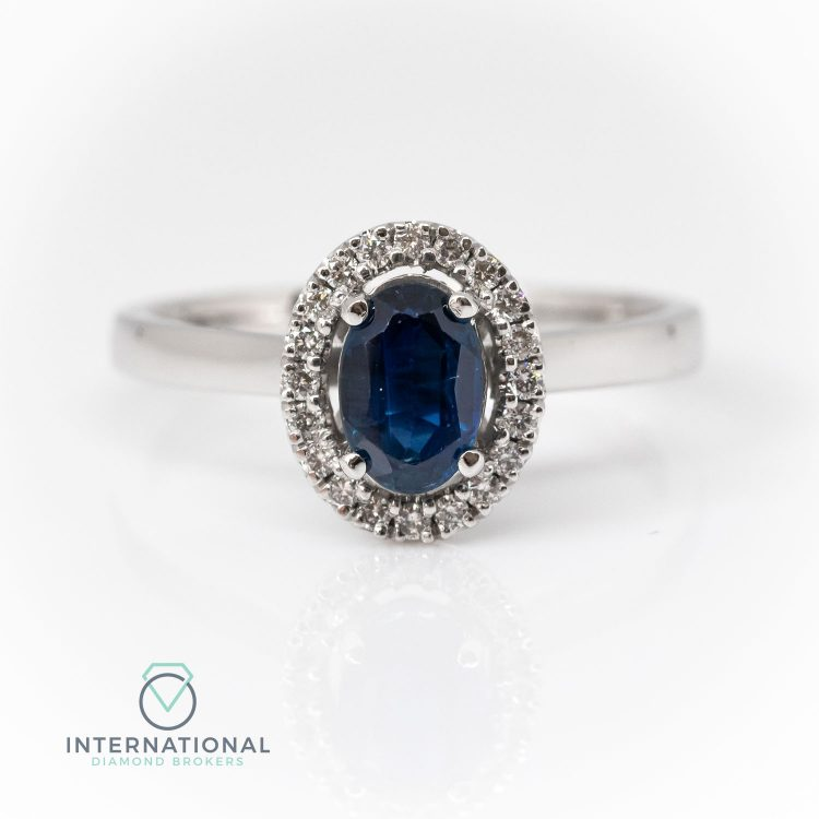 18ct White Gold, Oval Sapphire & Diamond Halo Cluster Ring