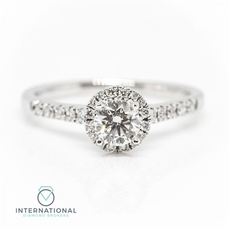 18ct White Gold & 0.85ct Diamond Halo Engagement Ring